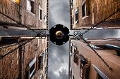 foto of pov  - point of view of a dark alley with gloomy sky in Venice Italy - JPG