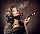stock photo of smoking woman  - Beauty Retro Woman with Mouthpiece - JPG