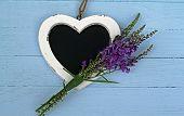 foto of duck egg blue  - Heart shaped chalk board with purple flowers - JPG