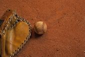 picture of infield  - a baseball and vintage glove on the infield - JPG