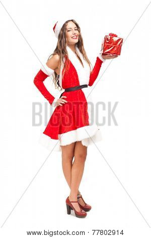 Beautiful full length portrait of a woman dressed in Christmas cloths