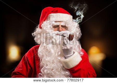 Santa Claus smoking a tobacco pipe