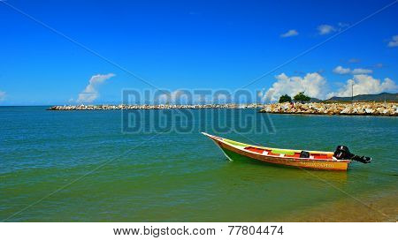 Anchored Boat In The Caribbean Sea