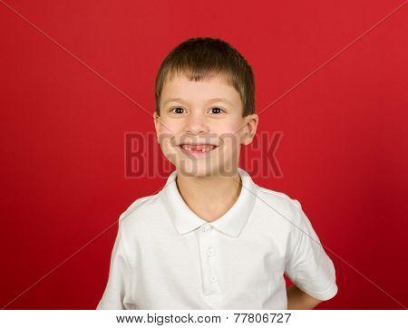 grimacing boy portrait on red background