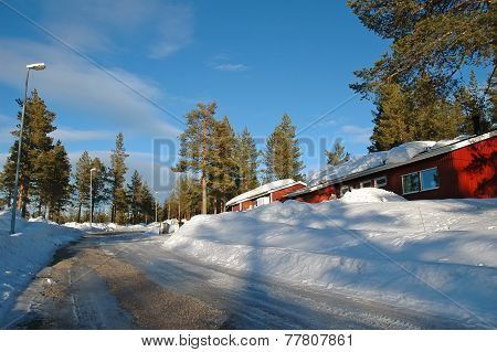 Swedish Wooden House In A Wintry Landscape