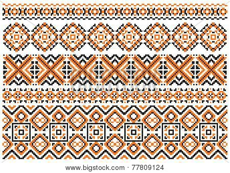 Close up cross stitch ethnic borders and patterns