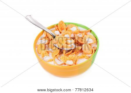 Bowl of corn flakes with milk.