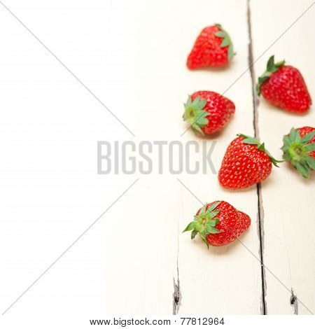 Fresh Organic Strawberry Over White Wood