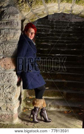 Redhead Girl Standing By The Wall