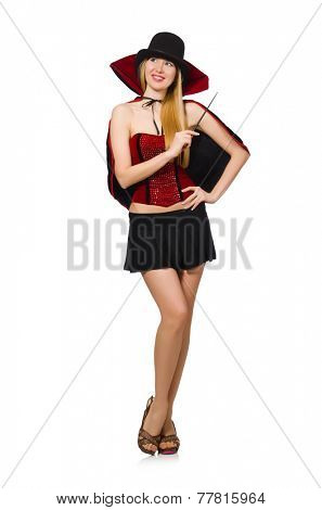 Woman magician with magic wand on white