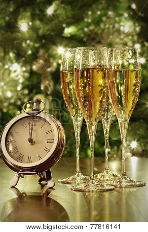 Champagne glasses, clock with lights at midnight