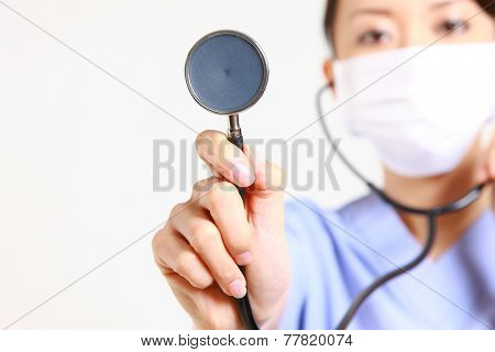 doctor auscultating with stethoscope
