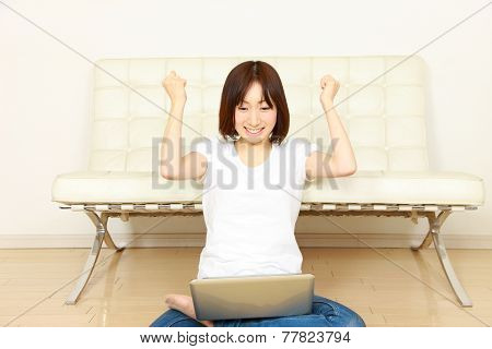 Japanese woman with computer pleased