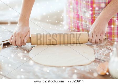 cooking and home concept - close up of female working with rolling-pin