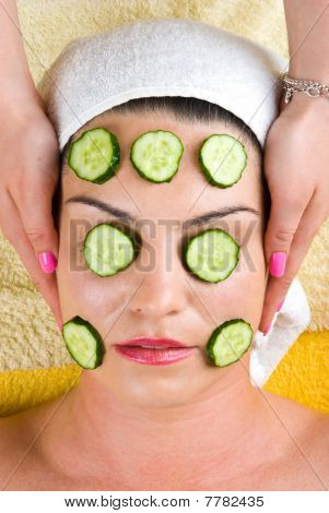 Woman With Cucumber Slice Facial  Mask At Spa
