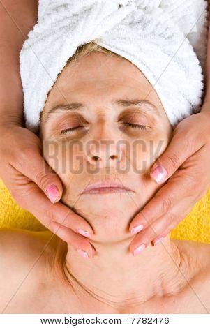Senior Woman Receiving A Facial Massage