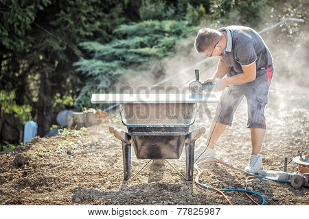 handyman working with grinding machine outside
