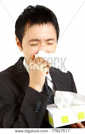 businessman suffer from a runny nose