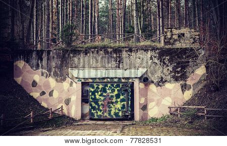 Retro Filtered Picture Of A Bunker In Forest.