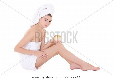 Depilation Concept - Beautiful Woman Wrapped In Towel Sitting With Cream Isolated On White
