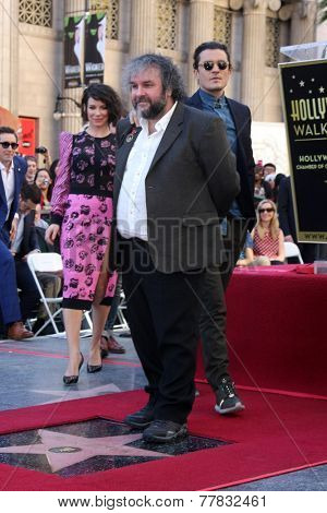 LOS ANGELES - DEC 8:  Evangeline Lilly, Sir Peter Jackson, Orlando Bloom at the Peter Jackson Hollywood Walk of Fame Ceremony at the Dolby Theater on December 8, 2014 in Los Angeles, CA