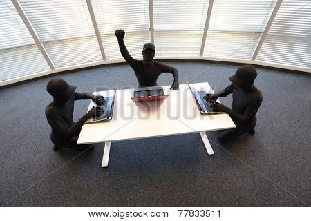 team of anonymous hackers in black costumes working with computers in office