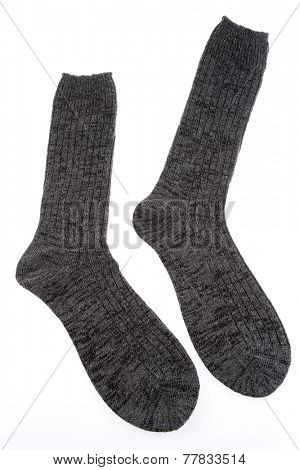 Pair of socks on plain background