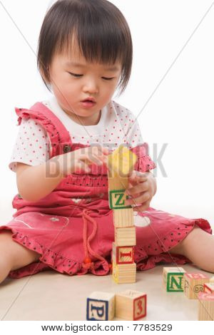 Little Asian Girl Playing