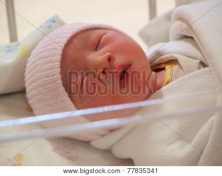 Newborn baby on the bed