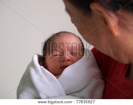 Newborn baby in the hand
