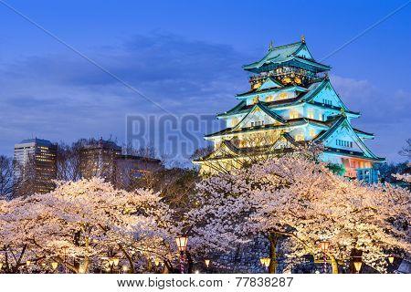 Osaka, Japan at Osaka Castle during the spring cherry blossom season.
