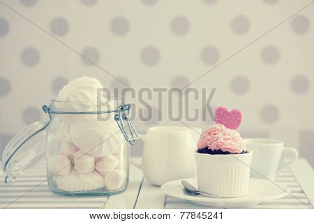 A shabby chic cupcake on a table lifestyle photo