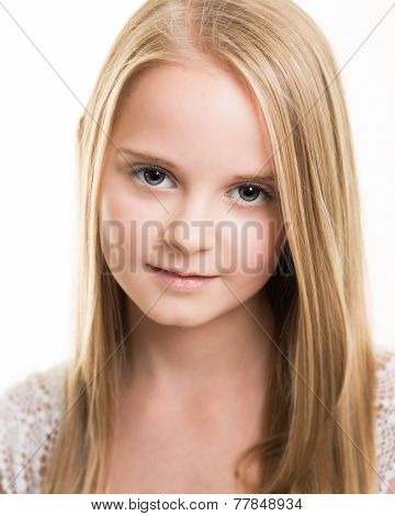 Blond Young Teenage Girl Dressed In White In The Studio