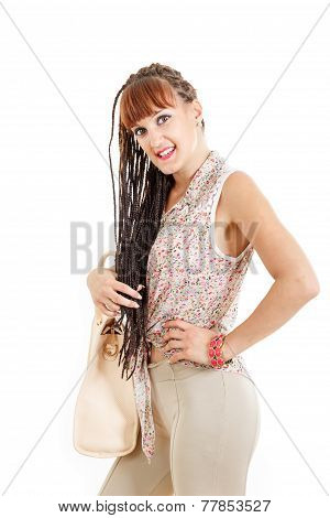Girl Or Woman With Extended Braids Hair In Tight Brown Pants And Shirt With Bag