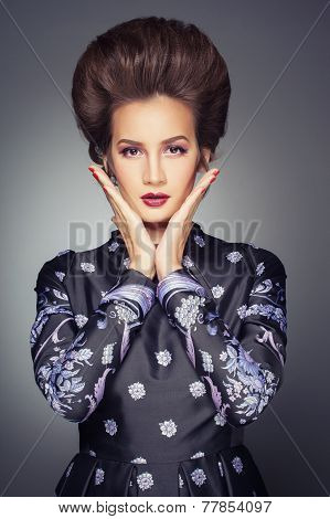 Old fashioned sexy woman in long dress with beautiful creative hairstyle