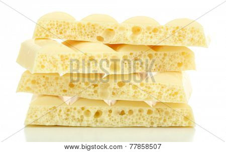 Tasty porous chocolate, isolated on white