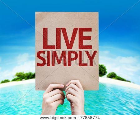 Live Simply card with a beach on background