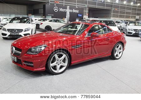 VALENCIA, SPAIN - DECEMBER 4, 2014: A red 2015 Mercedes Benz SLK350 Roadster at the Valencia Automovil 2014 Car Show.