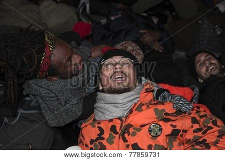 Supine protesters performing die in