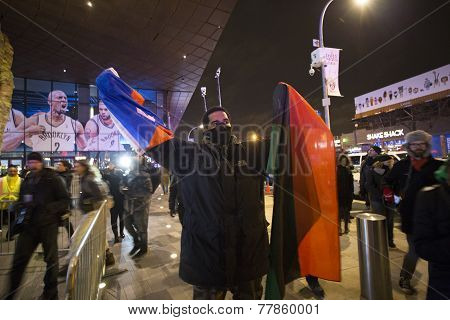 Masked activist with flags