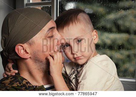 Sad scene farewell of the son to father leaving on military service