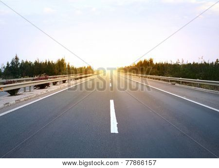 Long road at sunset