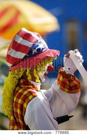 Clown handing balloon