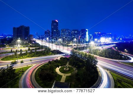 cityscape and traffic trails of beijing at night