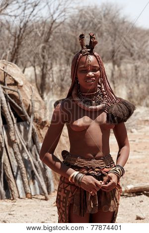 Himba Woman With Ornaments On The Neck In The Village