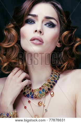 beauty rich woman with luxury jewellery looks like mature