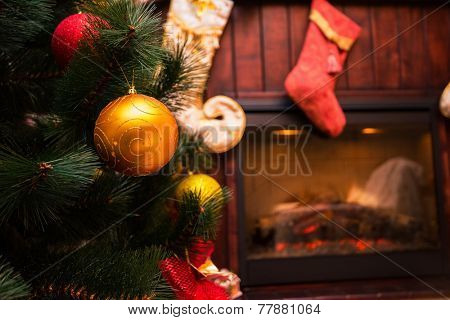 Christmas tree and in the interior with a fireplace
