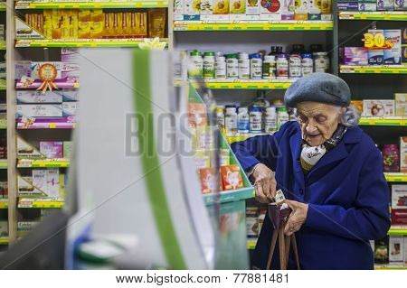 Elderly Womani In A Pharmacy