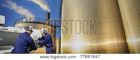 oil and gas workers and storage tanks