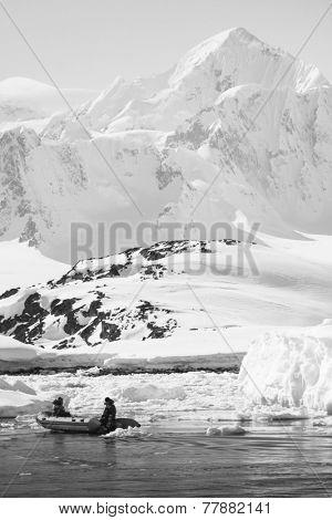 two men in the boat in Antarctica